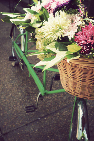bike basket full of wedding flowers