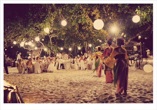 Malaysian dancers at beach wedding reception