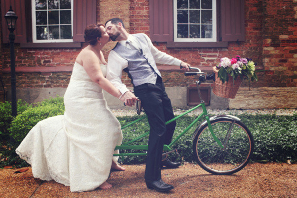 bride and groom on tandem bicycle