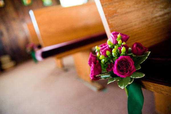 hot pink rose pew arrangements