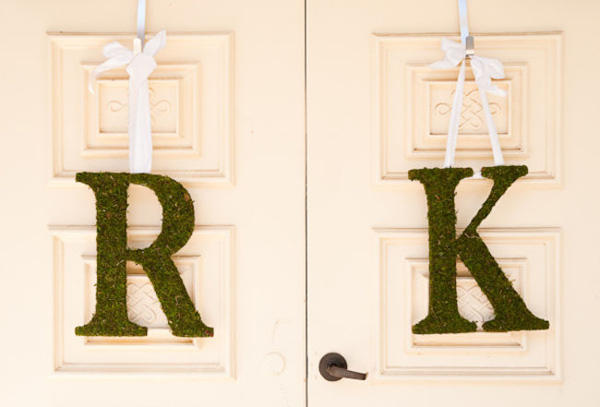 moss bride and groom monogram on chapel doors