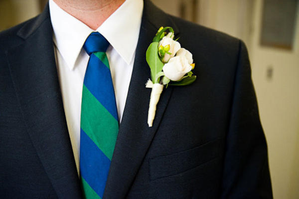 groom with green and blue striped tie