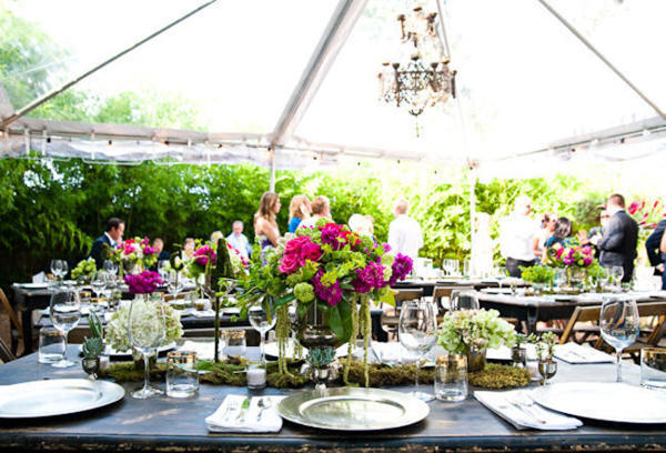 clear wedding tent reception with chandelier