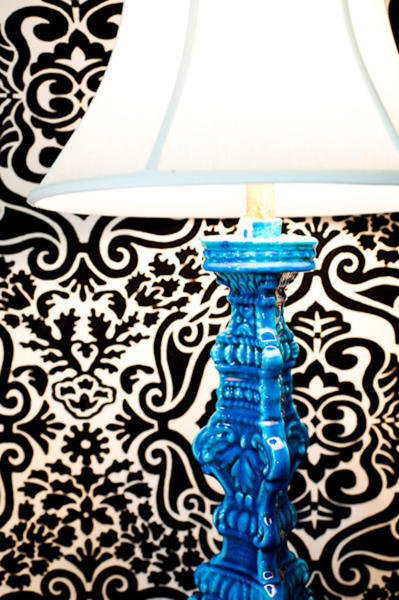 blue lamp against black and white wall