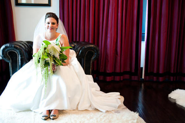 bride sitting in leather club chair