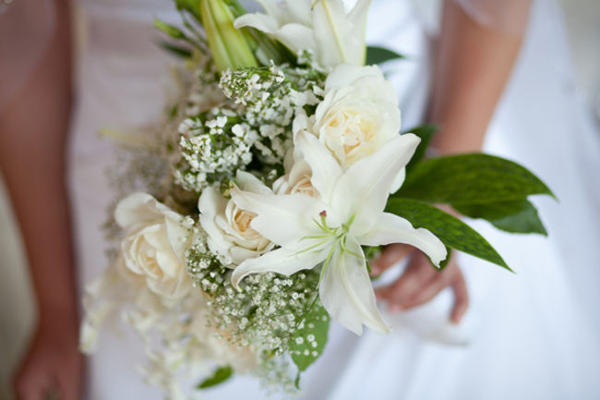 rose, lily, and baby's breath wedding bouquet
