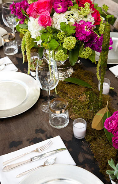 moss table runner and pink, red, and green centerpieces