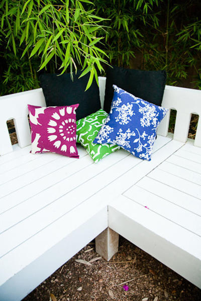 wedding bench with multi-colored pillows