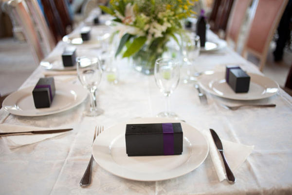 black box with purple ribbon wedding favor