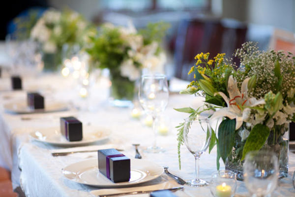 wedding table setting with boxed favors