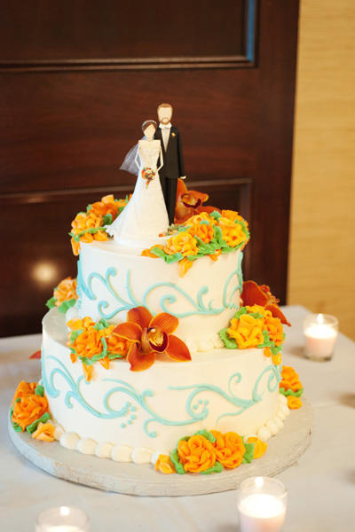 wedding cake with orange flowers
