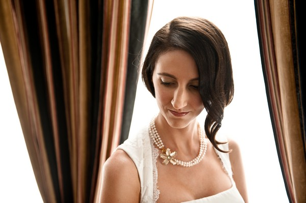 bride wearing pearl necklace
