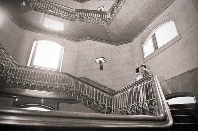 couple kissing on grand staircase