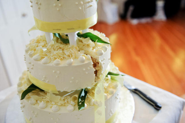 white and yellow wedding cake
