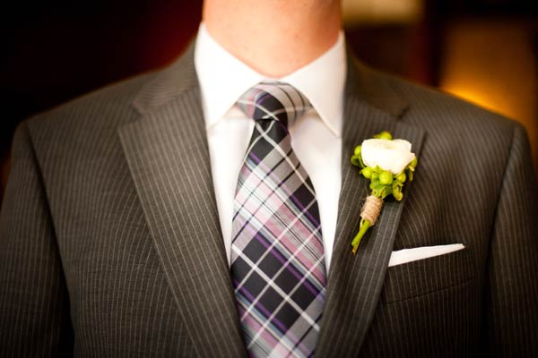groom in striped suit and purple plaid tie