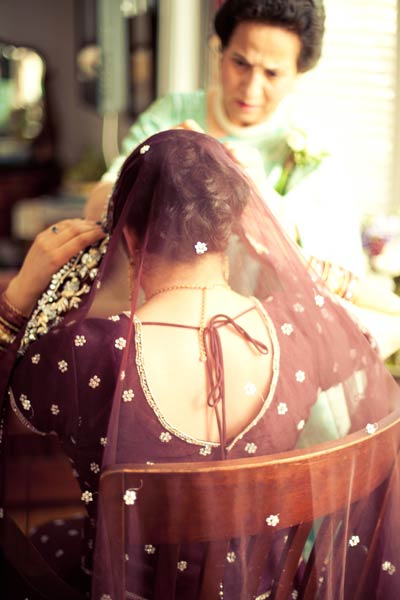 Indian bride adjusting her veil