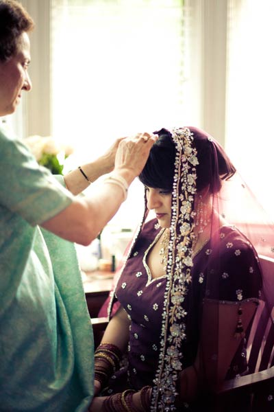 Mother of the bride adjusting her daughter's veil