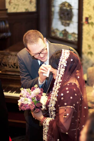 groom wiping bride's tears
