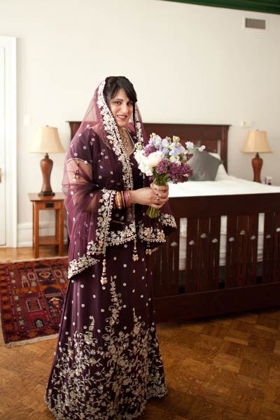 bride in purple sari