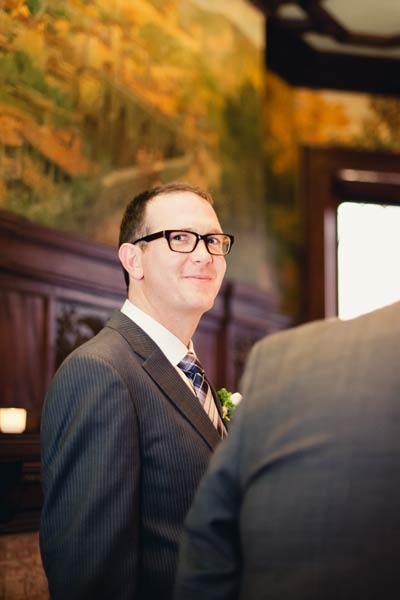 smiling groom wearing glasses