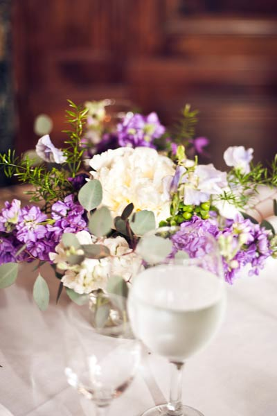 white, purple, and green floral centerpiece