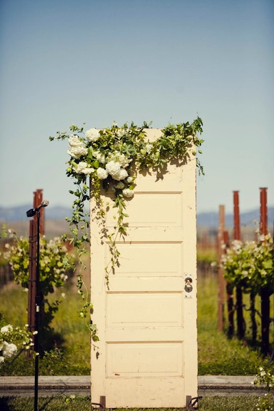 Another general door usage is well a door. These vintage doors are set up so that the couple can walk through them. I like the unexpected use of them ... & Vintage Door Wedding Decor
