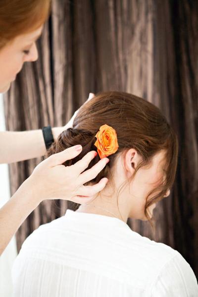 orange rose in bride's hair
