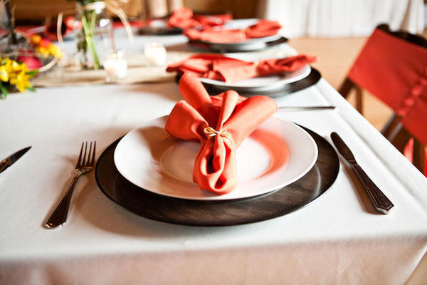 orange napkins on barn wedding table setting