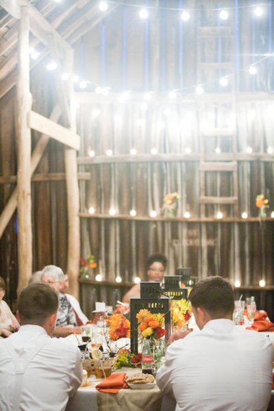 wedding reception in a barn with string lights