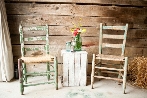 rustic farm chairs and mason jar flower arrangement