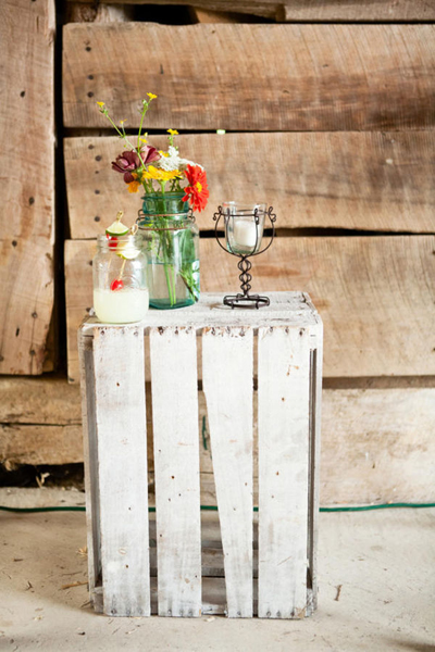 mason jar flower arrangement on wooden crate