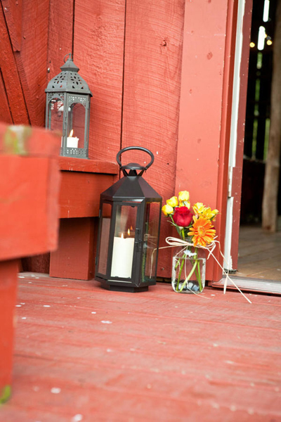 candle lanterns and mason jar flower arrangement