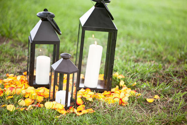 outdoor lanterns and orange rose petals