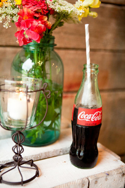 coke in glass bottle with striped straw