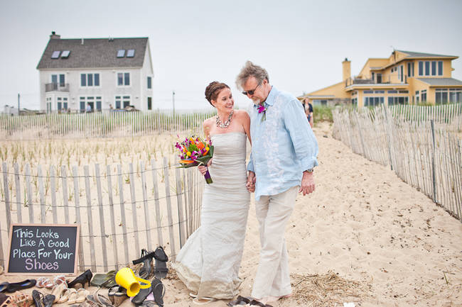 bride walking down the beach with her father