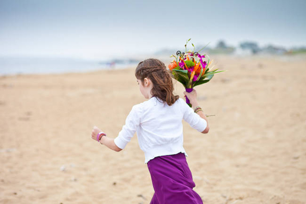 girl running with wedding bouquet