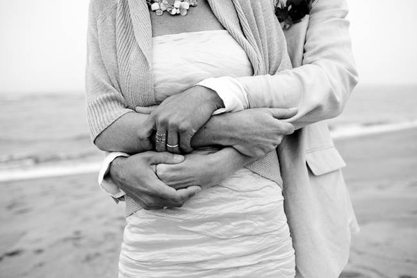 groom wrapping his arms around his bride