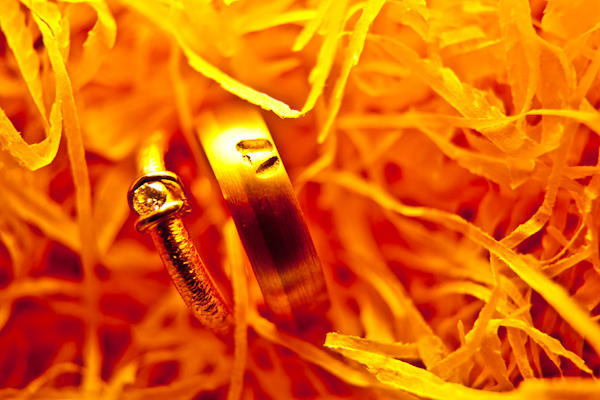 orange tinted photo of wedding rings