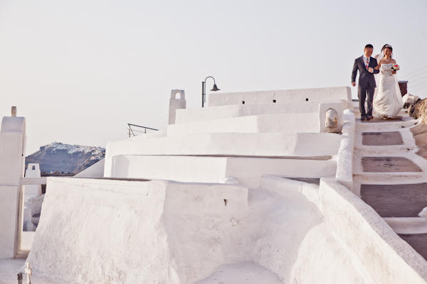 bride walking down stairs in Santorini