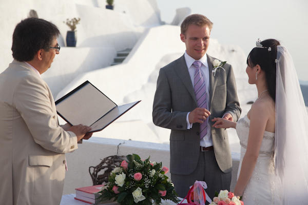 bride and groom exchanging vows in Santorini