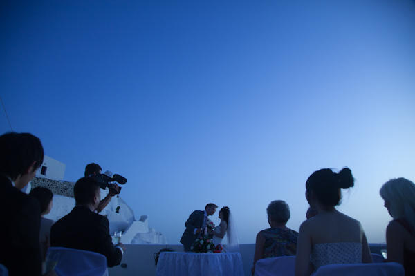 Outdoor wedding ceremony at dusk