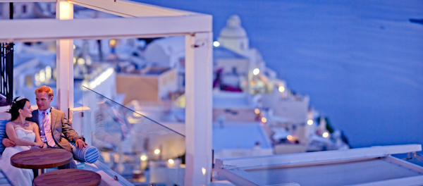 bride and groom on rooftop patio in Santorini