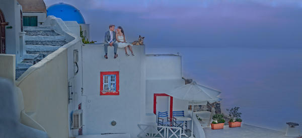 bride and groom sitting on the roof at dusk