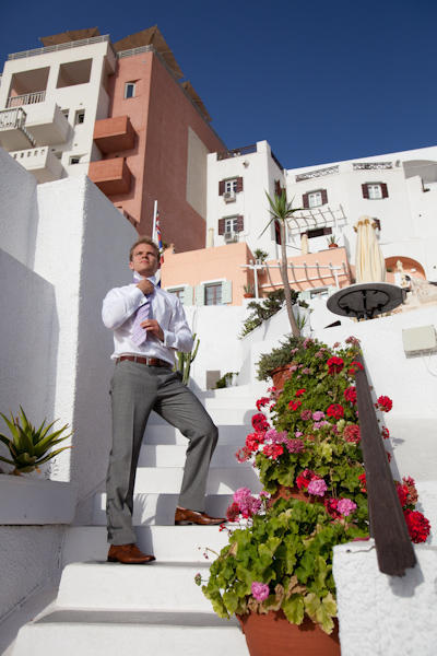 groom on whitewashed steps