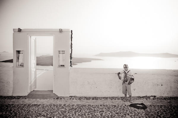 young boy playing accordion in Santorini