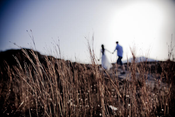 bride and groom walking in Santorini