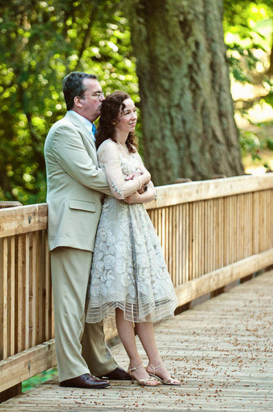 bride and groom on wooden walkway