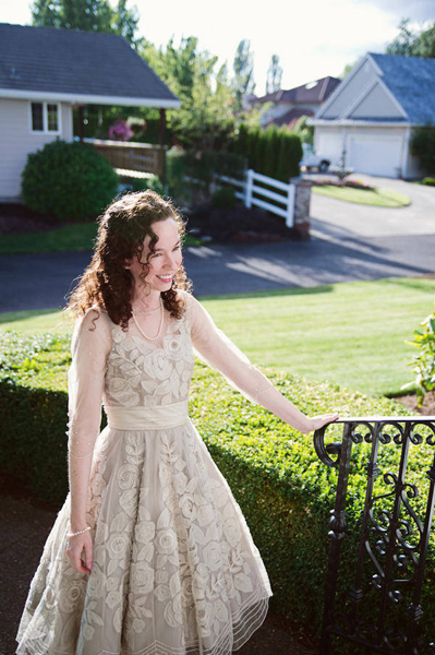 bride in BHLDN dress outside her house