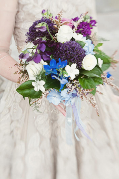 purple, blue, and white wedding bouquet