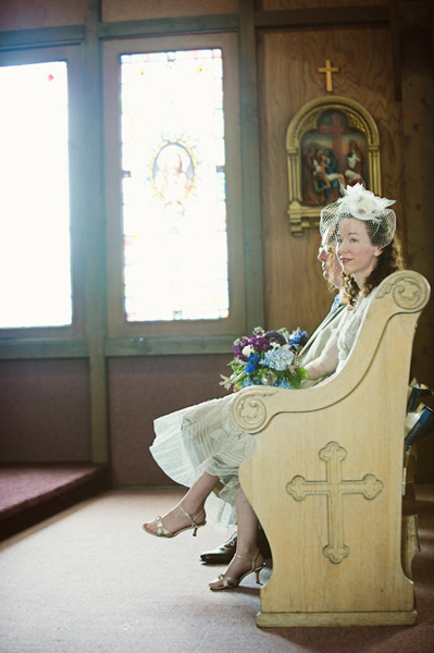 bride and groom in church pew